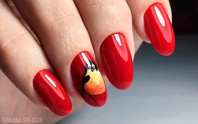 манікюр - червоні нігті із малюнком