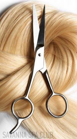 волосся і ножниці - символ жіночої стрижки